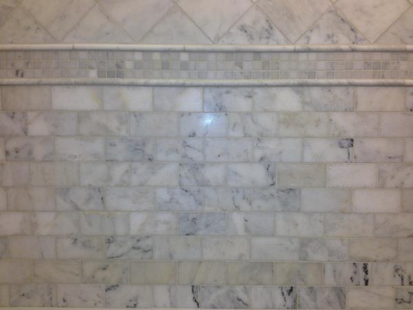 Attached Images. White Carrera Marble yellow after installation   Ceramic Tile