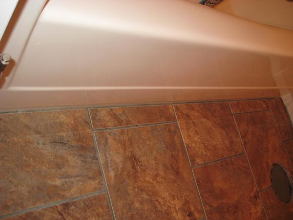 Grout vs. Caulking: Floor/Tub Transition - Ceramic Tile Advice ...