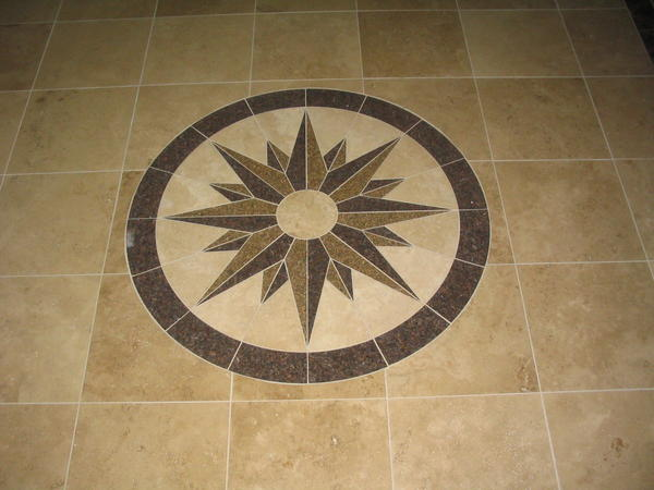 foyer tile layout with travertine and a medallion