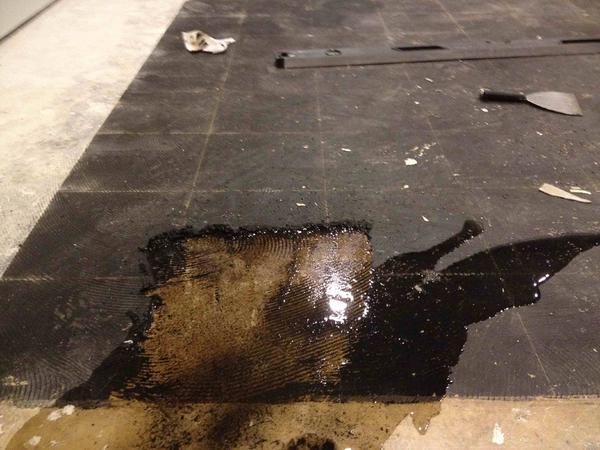 Self Leveling Compound Over Black Cutback Ceramic Tile