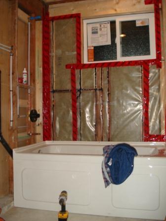 Started bathroom stuck vapor barrier redgard for Vapor barrier in bathroom