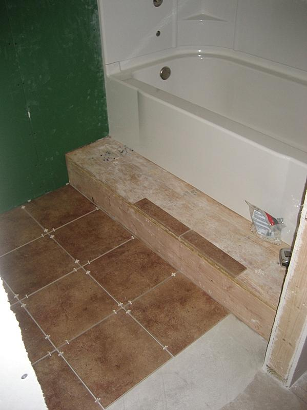 Laying Tile On Wooden Step Platform In Bathroom Ceramic