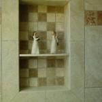 Angle stauettes inside a tile shower shampoo niche.
