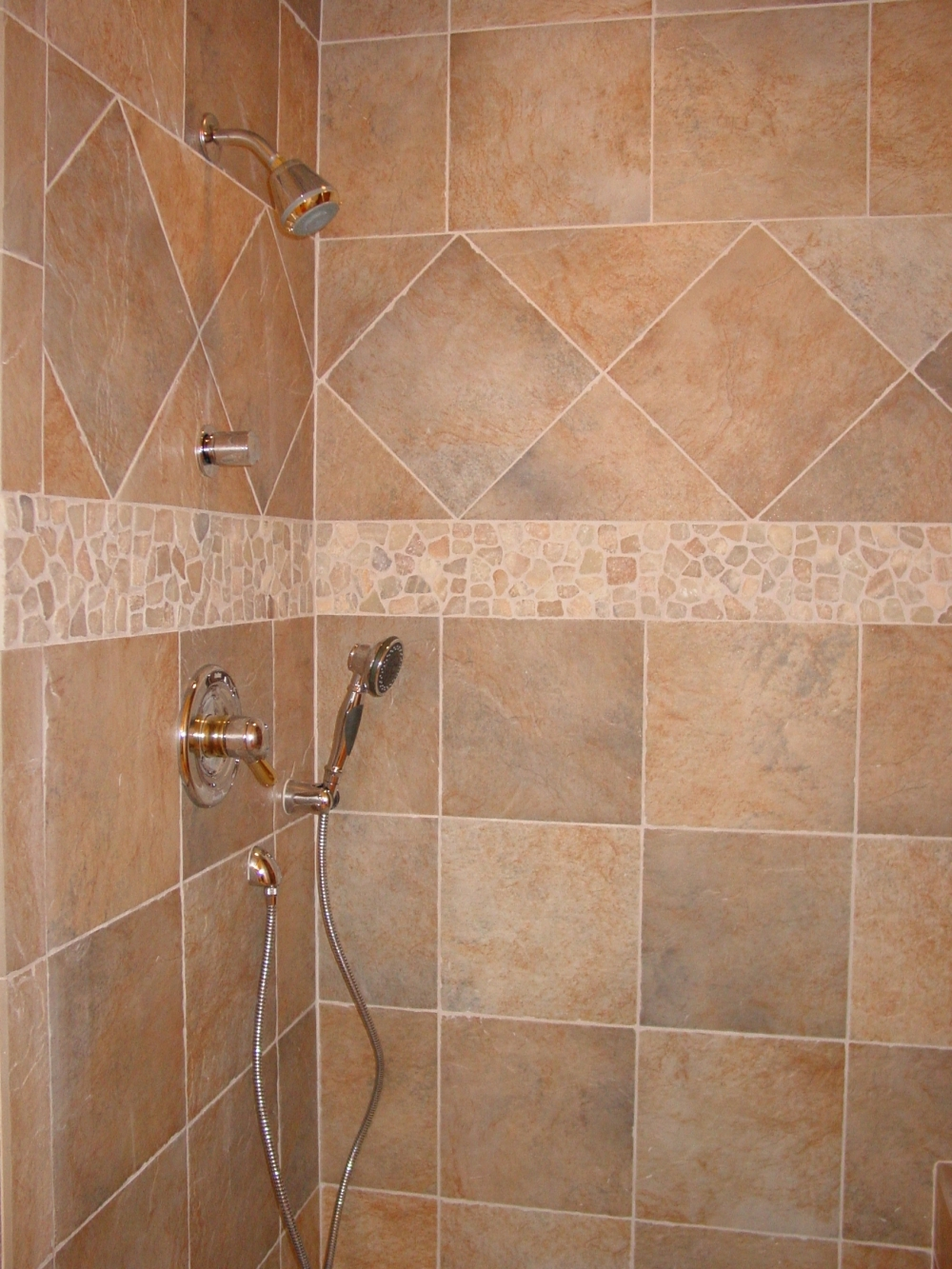 Pebble shower floors for tiled showers how to install small rocks tile your world Tile shower stalls