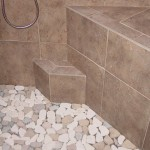 Shower floor edge is shown.