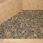 Shows rounded river rocks in a shower floor.