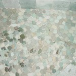 Ungrouted rocks. Some are wet.