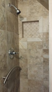 Shower interior showing niche and TileWare metal fixtures